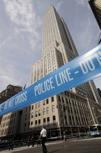 Police crime scene tape blocks 34th St. at Fifth Avenue after a multiple shooting outside the Empire State Building, Friday, Aug. 24, 2012, in New York.  At least four people were shot on Friday morning and the gunman was dead, New York City officials said. A witness said the gunman was firing indiscriminately. Police said as many as 10 people were injured, but it is unclear how many were hit by bullets. A law enforcement official said the shooting was related to a workplace dispute. The official spoke on condition of anonymity because the investigation was ongoing. (AP Photo/Mark Lennihan)