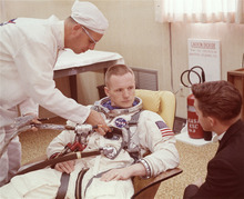 FILE - In this March 9, 1966 file photo, Astronaut Neil Armstrong is seated during a suiting up exercise Cape Kennedy, Florida, in preparation for the Gemini 8 flight.  The family of Neil Armstrong, the first man to walk on the moon, says he has died at age 82. A statement from the family says he died following complications resulting from cardiovascular procedures. It doesn't say where he died. Armstrong commanded the Apollo 11 spacecraft that landed on the moon July 20, 1969. He radioed back to Earth the historic news of