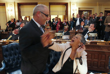 FILe - In this Feb. 16, 2012, file photo, Assemblyman Reed Gusciora D-Trenton, left, and Assemblywoman Bonnie Watson Coleman D-Mercer, congratulate each other as the bill sponsored by Rep. Gusciora legalizing same-sex marriages, passes and is the final Legislative approval for Marriage Equality at the State House in Trenton, N.J. The 42-33 vote sends the bill to Gov. Chris Christie. The Republican governor who opposes gay marriage had promised