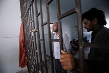 In this Friday, Aug. 24, 2012 photo, Syrian prisoners stand by the doorway of a makeshift prison run by rebels in a former elementary school in Al-Bab on the outskirts of Aleppo, Syria. Many improvised detention centers have sprung up as rebels wrest cities from army control, but these facilities fall under no national or regional authority, causing concern among rights groups. (AP Photo/Muhammed Muheisen)