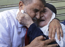 RETRANSMISSION FOR ALTERNATIVE CROP -- Hussein Ali Omar, 60, one of 11 Lebanese Shiite pilgrims that Syrian rebels have been holding for three months in Syria, hugs his mother, right, upon arrival at his house in the southern suburb of Beirut, Lebanon, 2012. Syrian rebels freed Omar on Saturday in a move aimed at easing cross-border tensions after a wave of abductions of Syrian citizens in Lebanon. The Shiite pilgrims were abducted May 22 after crossing into Syria from Turkey on their way to Lebanon. (AP Photo/Hussein Malla)