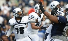 Rick Egan  | The Salt Lake Tribune   Utah State Aggies quarterback Chuckie Keeton (16) looks for a receiver as he gets pressure from Brigham Young Cougars defensive lineman Hebron Fangupo (91) in football action, BYU vs Utah State,  in Provo, Friday, September 30, 2011.