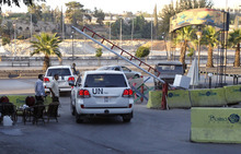 Lt. Gen. Babacar Gaye, the head of the failed United Nations Supervision Mission in Syria, departs for Lebanon in a UN convoy from his residence at the Dama Rose hotel in Damascus, Syria, Saturday, August 25,  2012. The observers' deployment in April that had intended to supervise a truce that never took hold, was one of the only concrete achievements in former Special Envoy Kofi Annan's attempts to halt the country's escalating civil war. There sign in Arabic reads