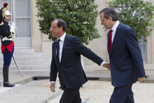 France's President Francois Hollande, left,  welcomes Greece's Prime Minister Antonis Samaras at the Elysee Palace, Saturday, Aug. 25, 2012. As the country's Prime Minister, Antonis Samaras, heads around Europe for top-level talks on Greece's attempts to right its finances, austerity-weary Greeks back home are preparing themselves for new pain amid fears that they may be kicked out of the 17-country group that uses the euro. (AP Photo/Michel Euler)