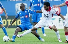 Montreal Impact's Collen Warner, left, is tackled by D.C. United's Dwayne De Rosario during second half MLS soccer action in Montreal, Saturday, Aug. 25, 2012.  (AP Photo/The Canadian Press, Graham Hughes)