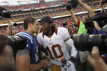 Indianapolis Colts quarterback Andrew Luck, left, greets Washington Redskins quarterback Robert Griffin III after an NFL preseason football game Saturday, Aug. 25, 2012, in Landover, Md. The Redskins won 30-17. (AP Photo/Alex Brandon)