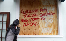A person walks by a sign warning about Hurricane Isaac, in Key West, Fla., Sunday, Aug. 26, 2012. Isaac gained fresh muscle Sunday as it bore down on the Florida Keys, with forecasters warning it could grow into a dangerous Category 2 hurricane as it nears the northern Gulf Coast. (Alan Diaz)