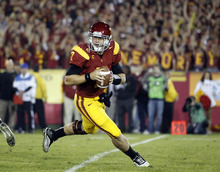 FILE - In this Nov. 26, 2011, file photo, Southern California quarterback Matt Barkley during an NCAA college football game against UCLA in Los Angeles. (AP Photo/Jae Hong, File)