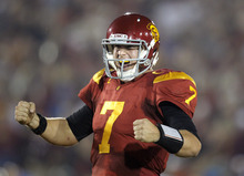 Southern California quarterback Matt Barkley celebrates a touchdown by Rhett Ellison during the first half of an NCAA college football game against UCLA in Los Angeles, Saturday, Nov. 26, 2011. (AP Photo/Jae Hong)