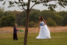 Trent Nelson  |  The Salt Lake Tribune Jen Comer plays catch with her son, T.J. Carver, at her wedding reception. Comer married Daniel Comer in Huntsville, Utah, Aug. 18, 2012.
