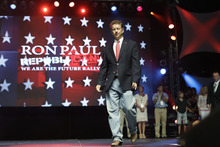 Sen. Rand Paul, R-Ky., takes the stage before his father Rep. Ron Paul, R-Texas, speaks at a rally at the University of South Florida Sun Dome on the sidelines of the Republican National Convention in Tampa, Fla., on Sunday, Aug. 26, 2012. (AP Photo/Charles Dharapak)