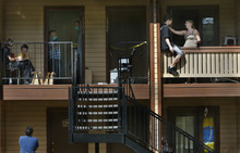 Scott Sommerdorf  |  The Salt Lake Tribune              Neighbors watch as police investigators search the apartment at 6999 S. State Street, #1503, where a man was shot to death Sunday, August 26, 2012 in Midvale.