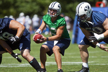 Chris Detrick  |  The Salt Lake Tribune BYU's Riley Nelson during a preseason practice at the BYU outdoor practice field Thursday August 2, 2012.