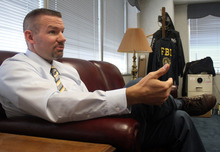 Rick Egan  | The Salt Lake Tribune  Special Agent Eric Zimmerman talks about the investigative tools that he has designed, at the FBI office in Salt Lake City. The National Center for Missing and Exploited Children recognized and awarded Zimmerman's accomplishments for software tools he designed to help fight sexual exploitation of children.