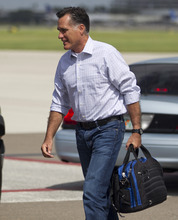 Republican presidential candidate, former Massachusetts Gov. Mitt Romney walks to his car after arriving at Tampa International Jet Center, Tuesday, Aug. 28, 2012, in Tampa, Fla.  (AP Photo/Evan Vucci)