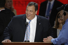 New Jersey Governor Chris Christie looks over the podium during a sound check at the Republican National Convention in Tampa, Fla., on Tuesday, Aug. 28, 2012. (AP Photo/J. Scott Applewhite)