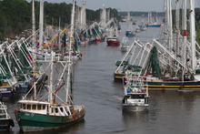 Boats seeking safe harbor from Tropical Storm Isaac fill the Industrial Canal in Gulfport, Miss., on Monday Aug. 27, 2012. (AP Photo/Sun Herald, John Fitzhugh)