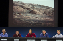 NASA scientists comment on the layer of the base of Mount Sharp, the Curiosity rover's eventual science destination during a briefing at NASA's Jet Propulsion Laboratory in Pasadena, Calif., Monday, Aug. 27, 2012. The above image is a portion of a larger image taken by Curiosity's 100-millimeter Mast Camera on Aug. 23, 2012. From left: Dave Lavery, Program Executive for Solar System Exploration at NASA Headquarters, Mike Malin, imaging scientist for the Mars Science Laboratory, John Grotzinger, MSL project scientist, California Institute of Technology, Paul Mahaffy, NASA Goddard Space Flight Center, and Dr. Chad Edwards, Chief Telecommunications Engineer for the Mars Exploration Program at JPL. (AP Photo/Damian Dovarganes)