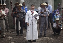 Father Luis Maria, spokesman of a religious group of followers of the Virgen del Rosario, delivers a speech against secular education in Nueva Jerusalen, Mexico, Monday, Aug. 27, 2012. Mexican authorities are still unable to overcome the resistance of an apocalyptic religious sect in western Mexico which has refused to allow public school teachers to hold classes in their town. (AP Photo/Alexandre Meneghini)