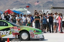 Trent Nelson  |  The Salt Lake Tribune Spectators take photographs at the starting line at the 64th annual Speed Week at the Bonneville Salt Flats.