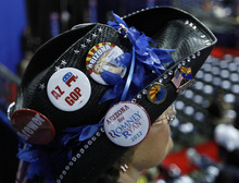 Arizona state senator and alternate delegate Gail Griffin, from Hereford, Ariz., wears a variety of buttons on her hat before the start of the Republican National Convention in Tampa, Fla., on Tuesday, Aug. 28, 2012. (AP Photo/Lynne Sladky)