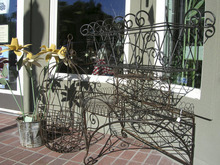 Photo #7 – BountifulÂ's Main Street businesses offer a variety of services to customers in this 2005 photo. Here, metal artwork casts late afternoon shadows in front of Me and My House. Photo taken 18 July 2005 by Janine S. Creager.