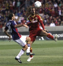Rick Egan  | The Salt Lake Tribune   Real Salt Lake's Kyle Beckerman (5)  goes for the ball, along with Nick LaBrocca, Chivas USA, in MLS soccer action in Sandy, Saturday, March 24, 2012.