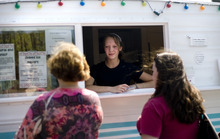Kim Raff | The Salt Lake Tribune Rachel Howard takes an order for shaved ice at the Wasatch Pops stand in Salt Lake City on Aug. 24, 2012.