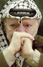 FILE - In this Aug. 13, 2003 file photo, Palestinian leader Yasser Arafat, with tears in his eyes, after he was informed of the death of his sister Yousra Abdel Raouf Al Kidwah at his compound in the West Bank town of Ramallah. French prosecutors opened a murder inquiry into the death of Yasser Arafat on Tuesday, Aug. 28, 2012, judicial officials told a French new agency, after his widow and a TV investigation raised new questions about whether the Palestinian leader was poisoned. (AP Photo/Nasser Nasser, File)