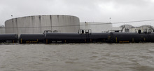 Railcars sit in floodwaters next to a chemical plant as Hurricane Isaac hits Wednesday, Aug. 29, 2012, in Braithwaite, La. (AP Photo/David J. Phillip)