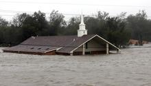 A church is flooded as Hurricane Isaac hits Wednesday, Aug. 29, 2012, in Braithwaite, La. (AP Photo/David J. Phillip)