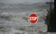 Isaac's winds and storm surge overcomes the seawall and floods South Beach Boulevard in Waveland, Miss., Wednesday, Aug. 29, 2012, the seventh anniversary of Hurricane Katrina hitting the Gulf Coast.  (AP Photo/Rogelio V. Solis)