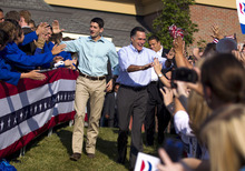 FILE - In this Aug. 25, 2012 file photo, Republican presidential candidate, former Massachusetts Gov. Mitt Romney and his vice presidential running mate Rep. Paul Ryan, R-Wis., arrive for a campaign rally in Powell, Ohio. They're the political world's newest odd couple: Mitt Romney and Paul Ryan are bound by substance, but dramatically different in style. The running mates share a love of policy, and a fascination with the world's economy and America's place in it. But where Romney is buttoned-up and reserved on the campaign trail, Ryan is relaxed and exudes a natural enthusiasm.  (AP Photo/Evan Vucci, File)