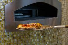 Chris Detrick  |  The Salt Lake Tribune Salsiccia pizza ($7.95) made with house marinara, mozzarella, parmigiano reggiano, fennel sausage, tomatoes, red onions, kalamata olives, olive oil and basil at Pizzeria Limone.