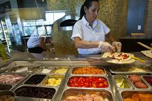 Chris Detrick  |  The Salt Lake Tribune Mirna Hekking makes a Salsiccia pizza at Pizzeria Limone on Aug. 24, 2012.