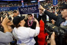 Trent Nelson  |  The Salt Lake Tribune A Ron Paul banner is pulled away from delegate Braedon Wilkerson at the Republican National Convention in Tampa, Fla.,  onTuesday.