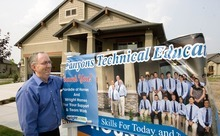 Paul Fraughton | The Salt Lake Tribune Ken Spurlock, principal of The Canyons Technical Educational Center, stands next to a poster showing some of the students from the CTEC program that helped build  the home at 569 E. Rosebowl Court, in Sandy. The house is featured as part of the Parade of Homes home show.