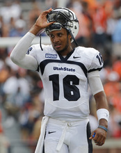 Utah State quarterback Chuckie Keeton (16) reacts near the end of a 42-38 loss to Auburn in an NCAA college football game in Auburn, Ala., Saturday, Sept. 3, 2011.  (AP Photo/Dave Martin)