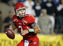 Utah quarterback Jordan Wynn (3) looks for an open receiver during the first half of an NCAA college football game against BYU, Saturday, Sept. 17, 2011, at LaVell Edwards Stadium in Provo, Utah. (AP Photo/Colin E Braley)