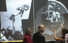 California Gov. Jerry Brown, second from left, tours NASA's Mars Curiosity rover mission operations center at the Jet Propulsion Laboratory in Pasadena, Calif., Wednesday, Aug. 22, 2012. From left: Peter Theisinger, MSL project manger, NASA JPL, Pasadena, Gov. Brown, Jessica Samuels, Engineering team lead for Surface Operations of Mars Science Laboratory. (AP Photo/Damian Dovarganes)