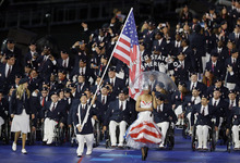 U.S. flagbearer discus thrower Scott Danberg from Cooper City, Fla. leads his team during the Opening Ceremony for the 2012 Paralympics in London, Wednesday Aug. 29, 2012. (AP Photo/Kirsty Wigglesworth)