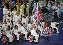 Britain's flag bearer Wheelchair tennis veteran Peter Norfolk leads the team into the arena during the Opening Ceremony for the 2012 Paralympics in London, Wednesday Aug. 29, 2012.   (AP Photo/Kirsty Wigglesworth)