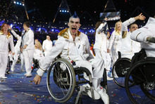 A member of the British team reacts during the Opening Ceremony for the 2012 Paralympics in London, Wednesday Aug. 29, 2012. (AP Photo/Matt Dunham)