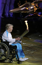Margaret Maughan, Britain's first Paralympic gold medalist,  lights the Paralympic flame during the Opening Ceremony for the 2012 Paralympics in London, Wednesday Aug. 29, 2012. (AP Photo/Kirsty Wigglesworth)