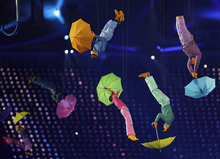 Performers with umbrellas are suspended in the air during the Opening Ceremony for the 2012 Paralympics in London, Wednesday Aug. 29, 2012.  (AP Photo/Kirsty Wigglesworth)