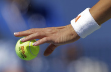 Serbia's Ana Ivanovic bounces a ball during her match with Sweden's Sofia Arvidsson in the second round of play at the 2012 US Open tennis tournament,  Thursday, Aug. 30, 2012, in New York. (AP Photo/Mike Groll)