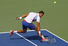 France's Jo-Wilfried Tsonga returns a shot to Slovakia's Martin Klizan in the second round of play at the 2012 US Open tennis tournament,  Thursday, Aug. 30, 2012, in New York. Fifth-seeded Tsonga was upset by Klizan in the second round. (AP Photo/Paul Bereswill)