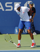 France's Jo-Wilfried Tsonga throws his racket down during his match against Slovakia's Martin Klizan in the second round of play at the 2012 US Open tennis tournament,  Thursday, Aug. 30, 2012, in New York. Fifth-seeded Tsonga was upset by Klizan in the second round.(AP Photo/Paul Bereswill)