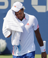 France's Jo-Wilfried Tsonga reacts during his match against Slovakia's Martin Klizan in the second round of play at the 2012 US Open tennis tournament,  Thursday, Aug. 30, 2012, in New York. Fifth-seeded Tsonga was upset by Klizan in the second round. (AP Photo/Paul Bereswill)