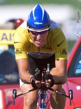 FILE - In this July 24, 1999 file photo, overall leader Lance Armstrong of the U.S. strains on his way to winning the 19th stage of the Tour de France cycling race, a 57-kilometer individual time trial around the Futuroscope theme park near Poitiers, western France. Tyler Hamilton makes allegations in his book,
